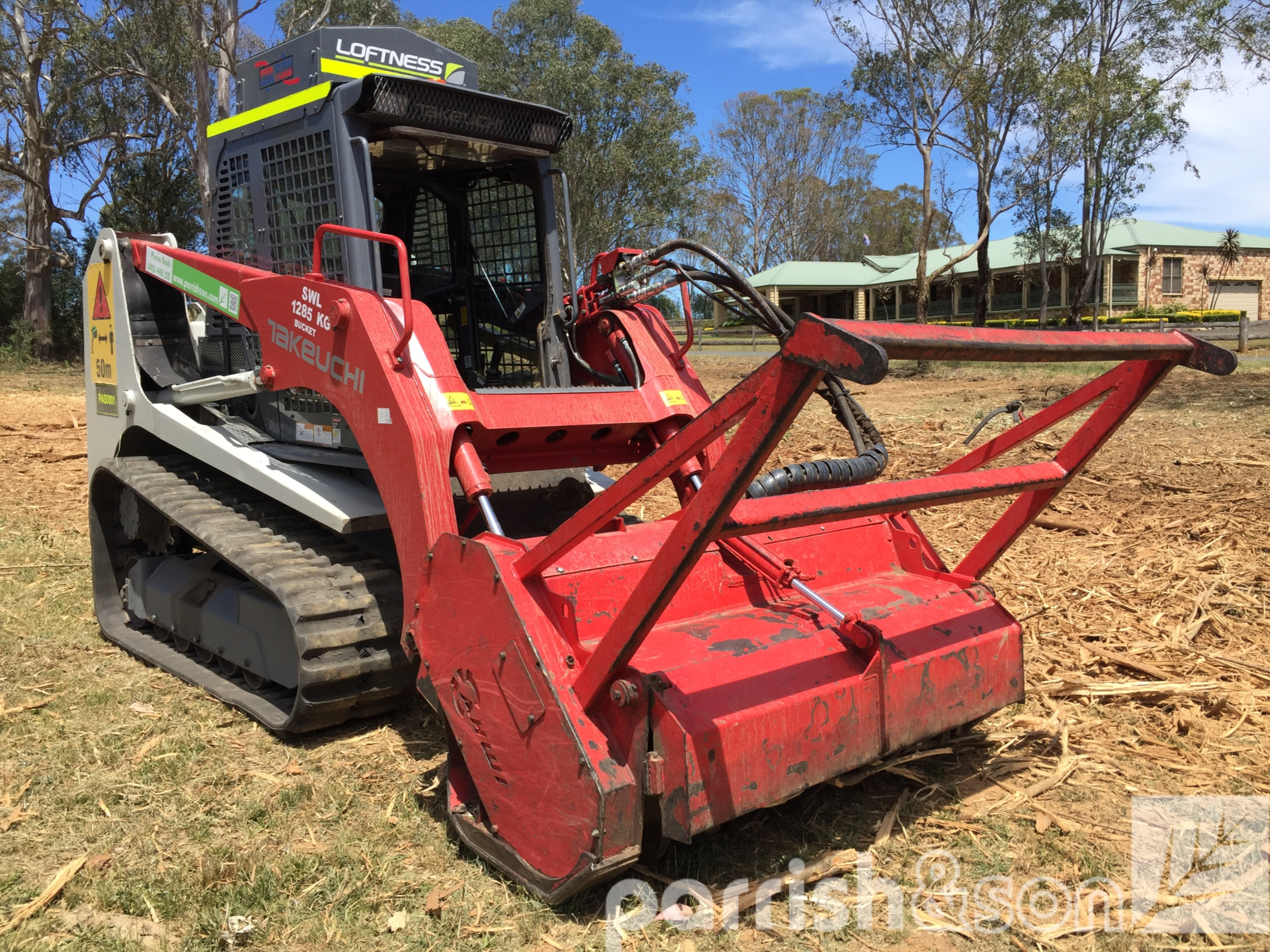 Takeuchi tracked loader with mulch attachment